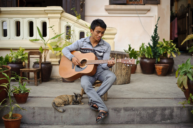 Thida Guesthouse Employee Playing Guitar