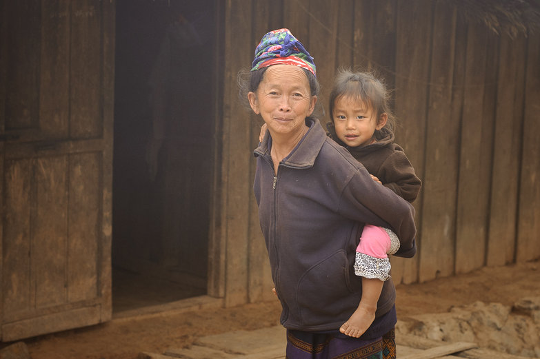 Lao Grandma Carrying Kid