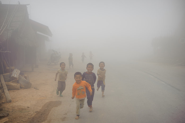 Lao Kids Running Towards Us Through the Mist