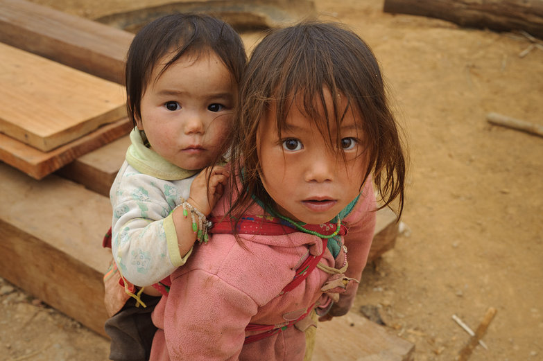 Little Lao Kid Carrying Little Lao Baby