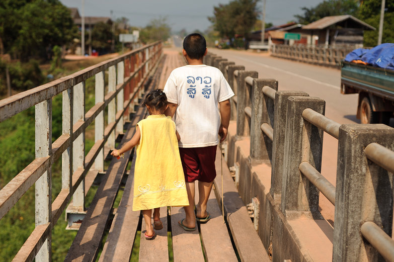 Lao Kids Crossing Bridge