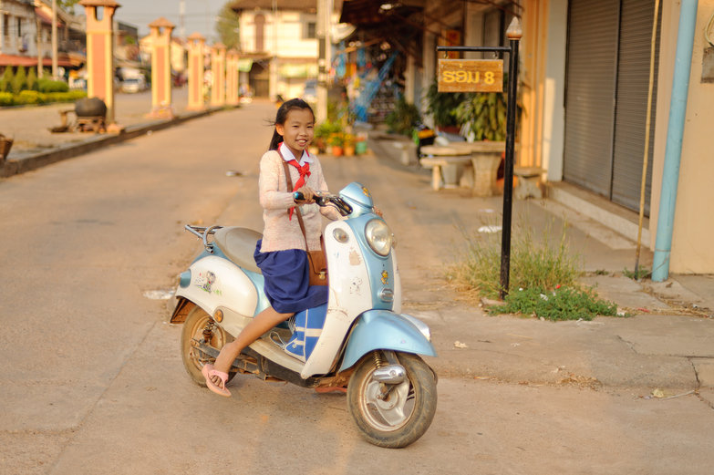 Lao School Girl on Scooter
