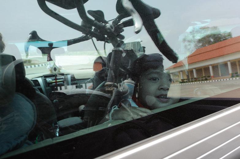 Reflection of Tyler's Bike in Pickup (No Cycling Allowed on Friendship Bridge)