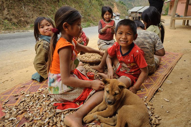 Lao Kids Eating Peanuts