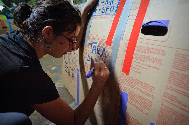 Tara Writing on Bike Box