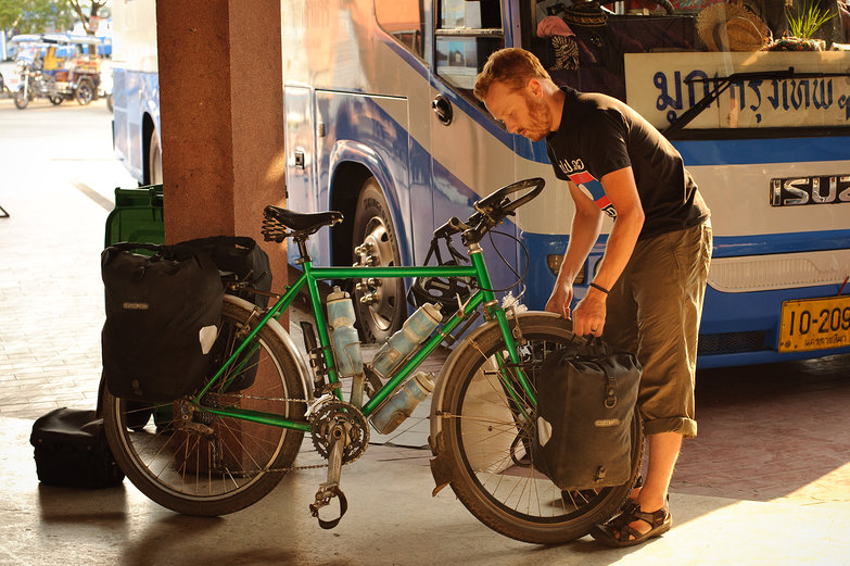 Tyler Removing Panniers at Bus Station