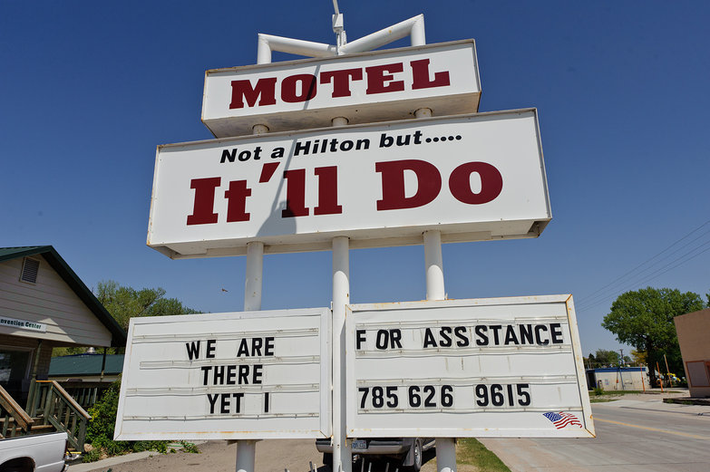 "Hotel Sign: ""Not a Hilton but... It'll Do"""