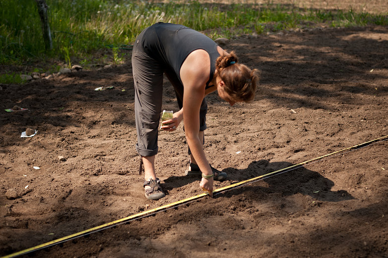 Tara Poking Two-Inch Holes for Seeds