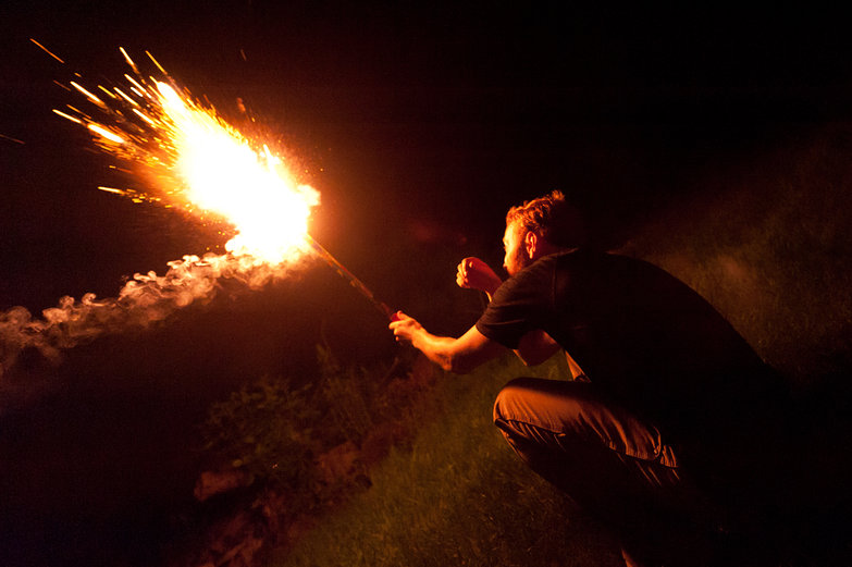 Tyler Holding Roman Candle