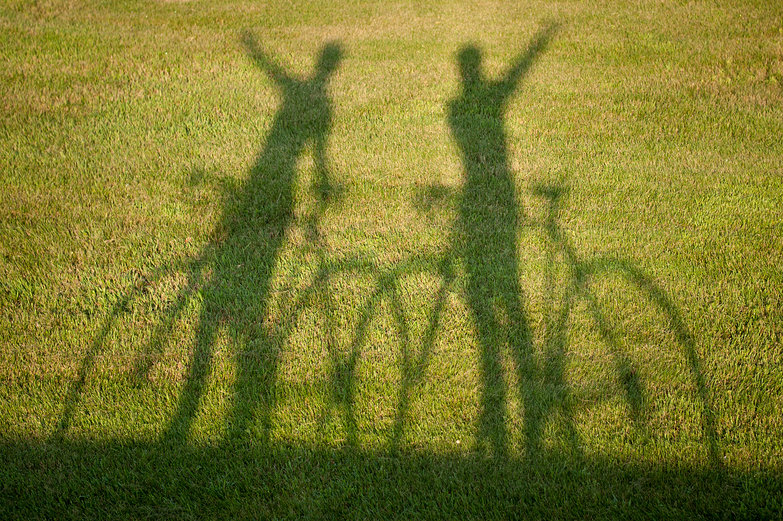 Us (Shadow of Us on our Road Bikes)