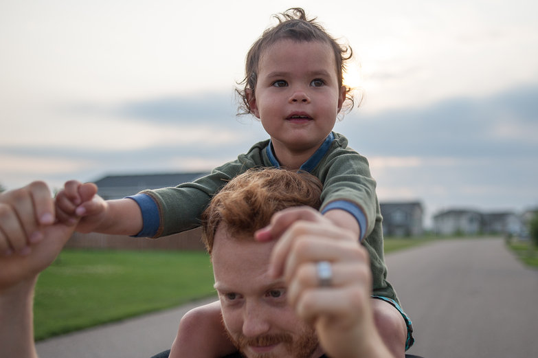 Tyler Giving Brynn a Ride on His Shoulders
