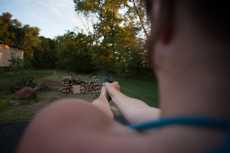 Tara Shooting a .22 Pistol