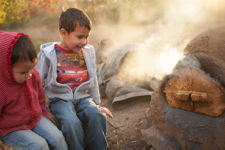 Brynn & Adrian by the Earthen Oven