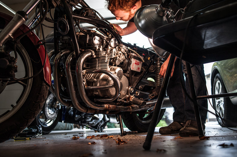 Tyler fixing Tara's Motorcycle