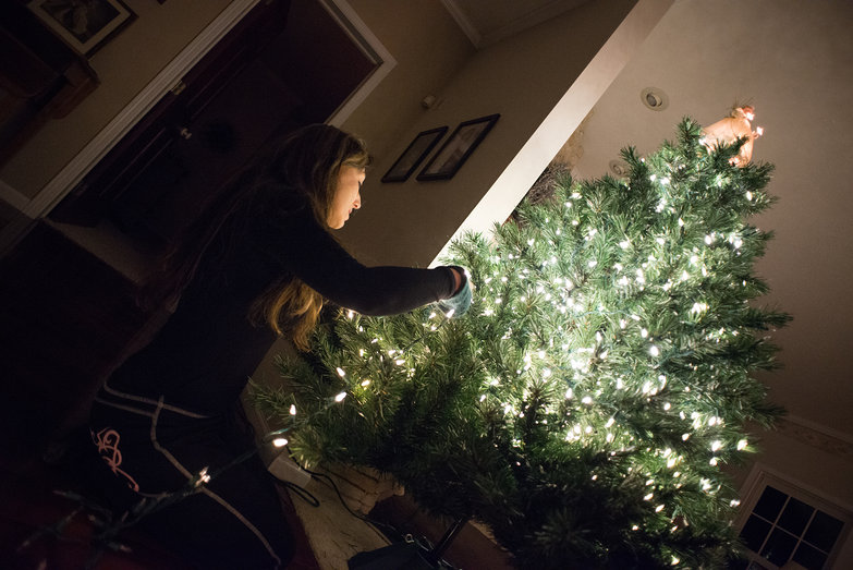 Mom Putting Lights on the Tree