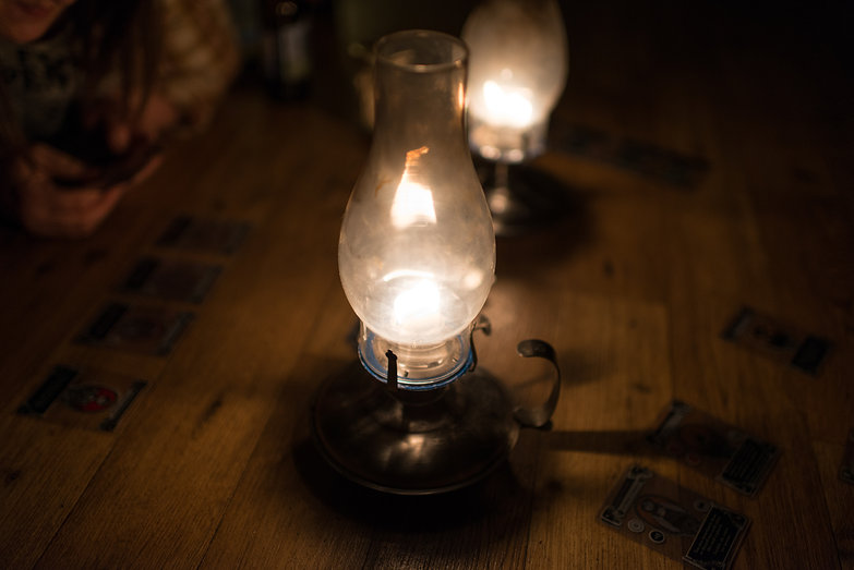 Playing Gloom by Oil Lamp