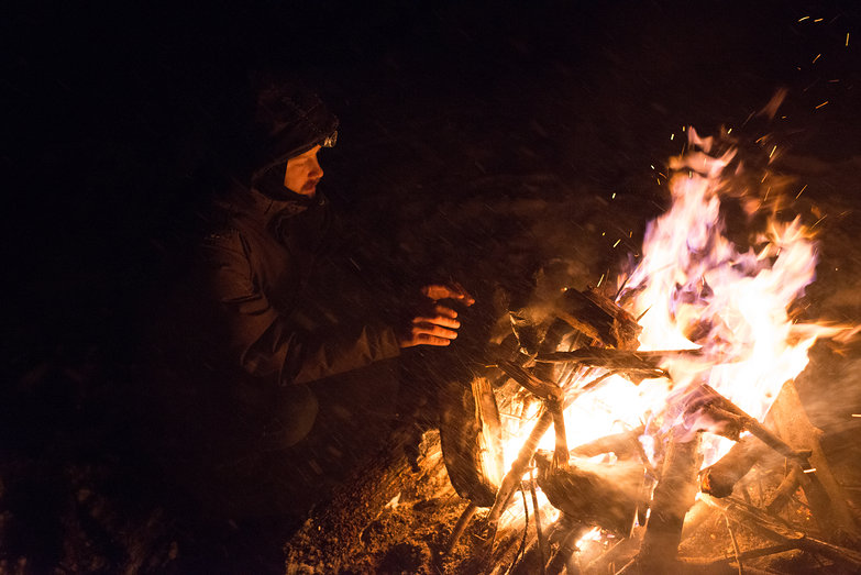 Tyler by a Fire in a Snowstorm