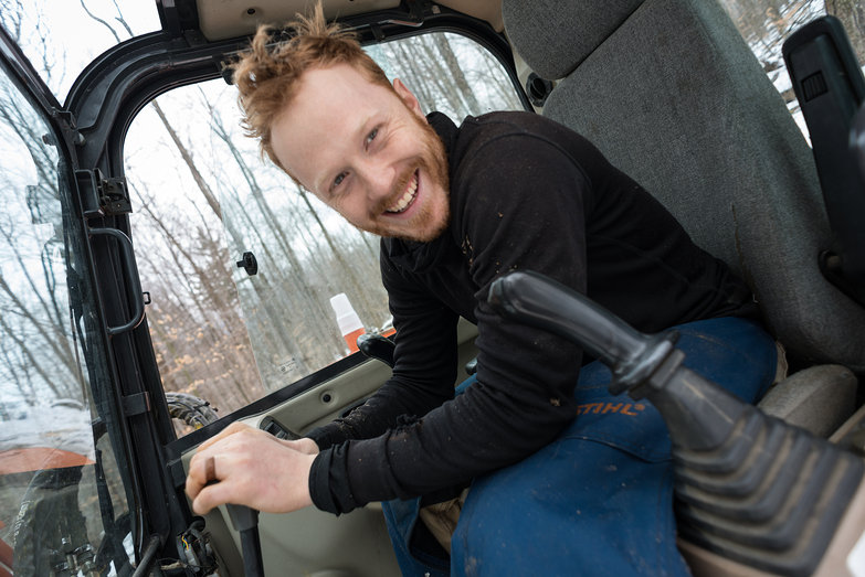 Happy Tyler Driving an Excavator