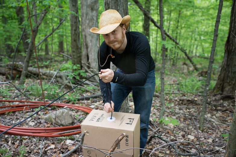 Tyler Pulling Cat5e Network Cable Through Our Woods