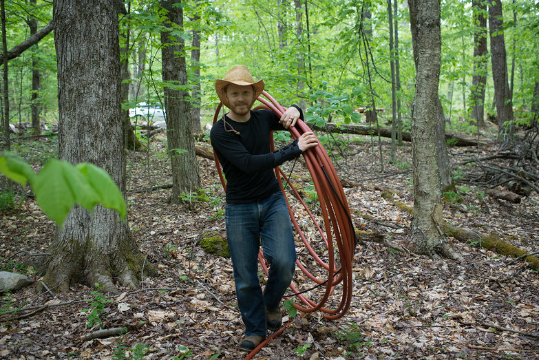 Tyler Pulling Conduited RG11 Coax Through Our Woods