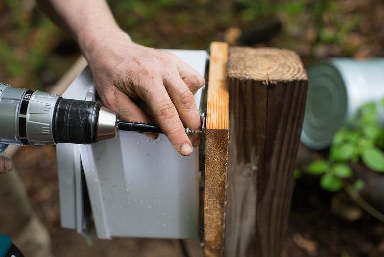 Tyler Installing Weatherproof Enclosure on Pole