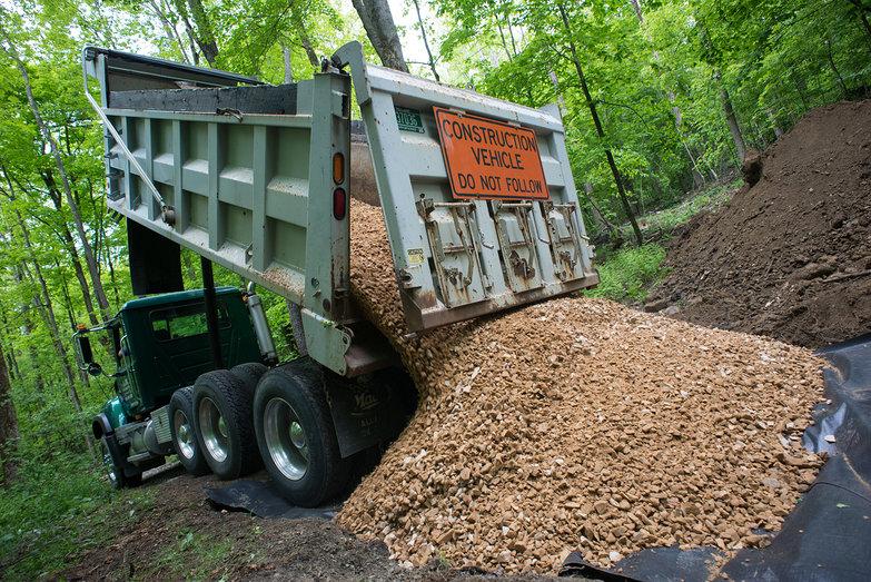 Truck Dumping Rock