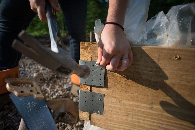 Tara Nailing Corner Brace on Concrete Form