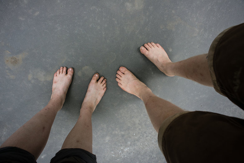 Our Feet on Workshop Concrete Floor