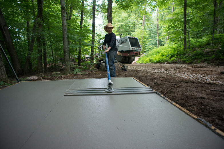 Tyler Using Bull Float to Smooth Concrete