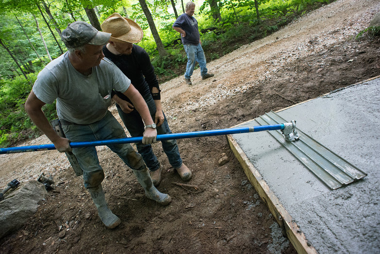 Pete & Tyler Using Bull Float to Smooth Concrete