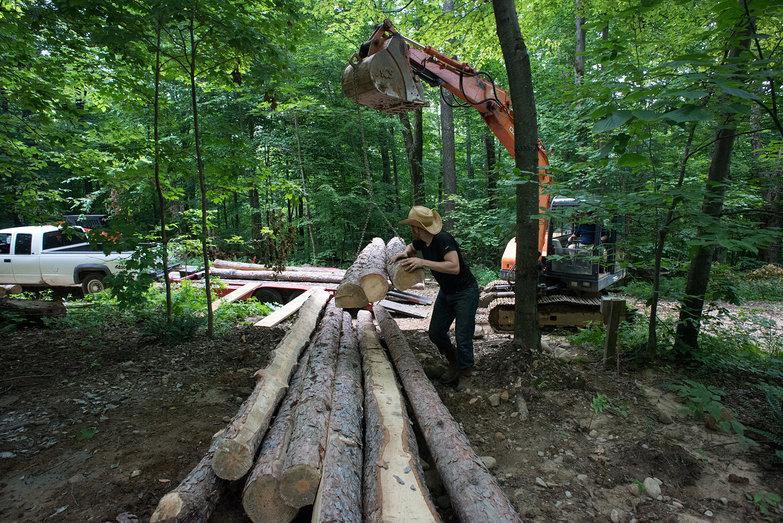 Tyler & Rick Unloading Rafter Logs