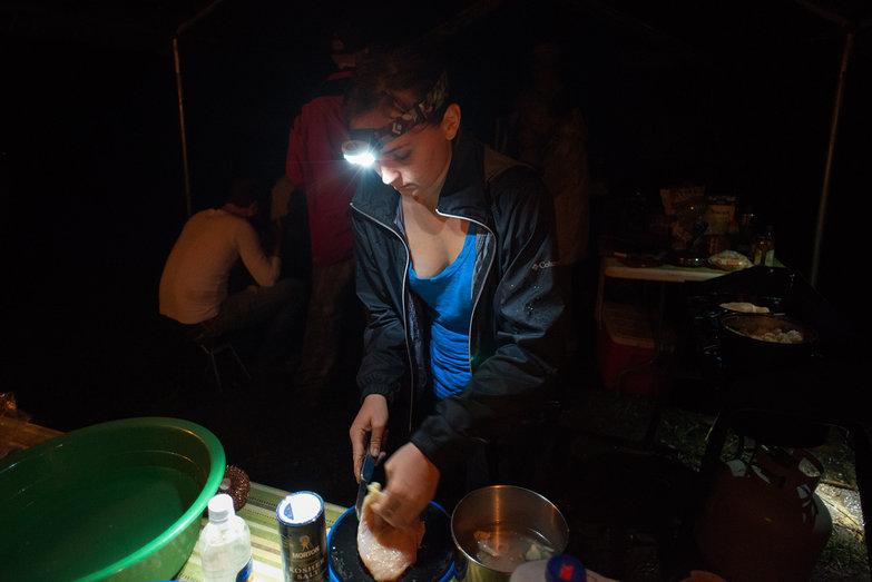 Rachel Cutting Chicken in Outdoor Kitchen