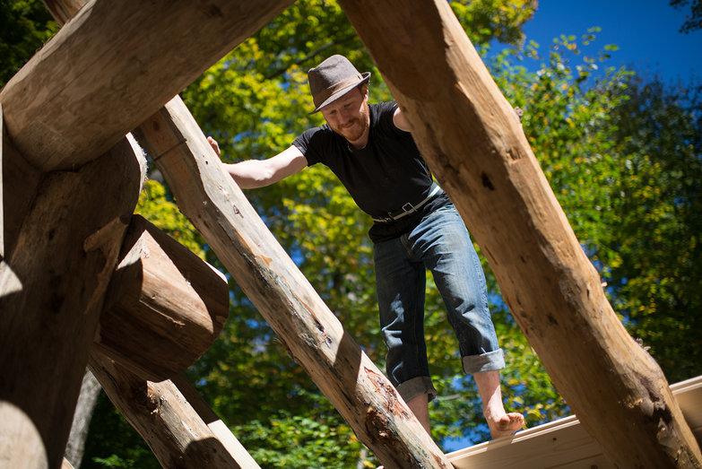 Tyler on Grindbygg Timber Frame Workshop Roof