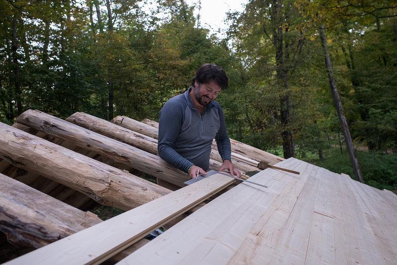 Jeremy Measuring Grindbygg Timber Frame Roof Decking