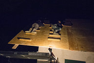 Us Constructing Cold Roof by Night