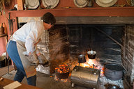 Adding Coals to Dutch Oven