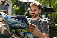 Lian Reading Shasta Lake Visitors' Guide