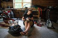 Tyler Assembling Wheels for Paramotor Quad