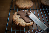 Spreading Chocolate on Low Carb Hob Nob Cookie